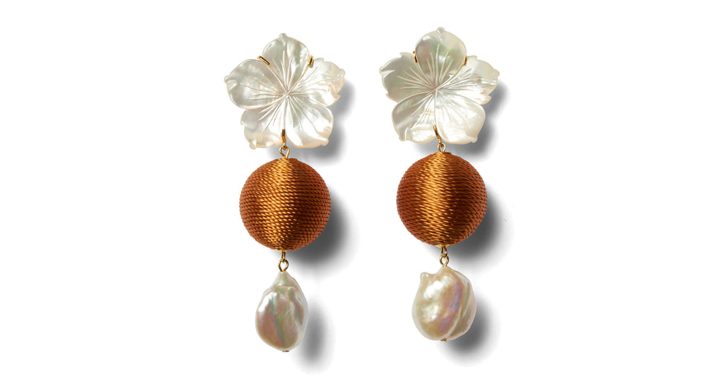 Full view of Paper White Drop Earrings In Amber. Bask in the ultra-flattering glow of our ca...