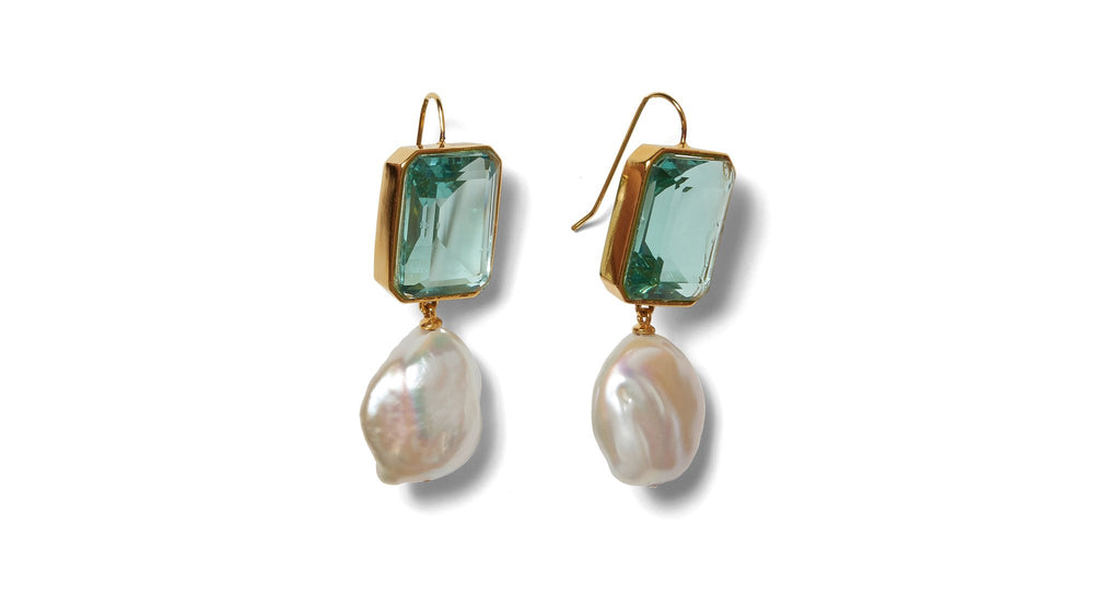 Full view of Aegean Earrings. Need some perfect little gems to tide you over til summer? Look no further than our radiant rectangle drop earrings, with aqua-colored quartz stones and hanging baroque freshwater pearls.