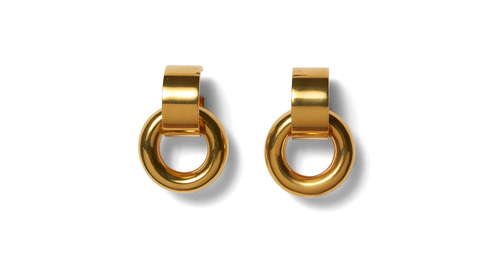 Full view of Piazza Earrings In Gold. Knock knock, your new favorite accessory is here. We&#...