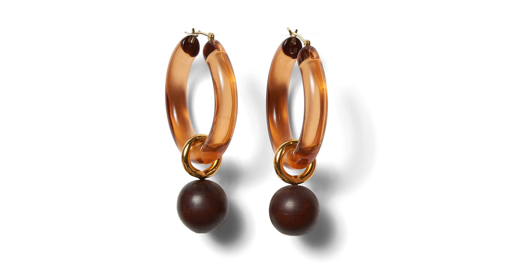 Full view of Spritz Hoops In Caramel. We love the ease and elegance of our large hoop earrin...