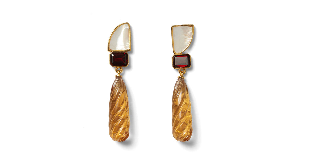 Full view of Amber Drop Earrings. This season Lizzie took inspiration from the golden-hued s...