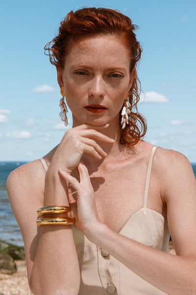 Thumbnail of model wearing the Roma Earrings. Swim into the style current with these ocean-i...