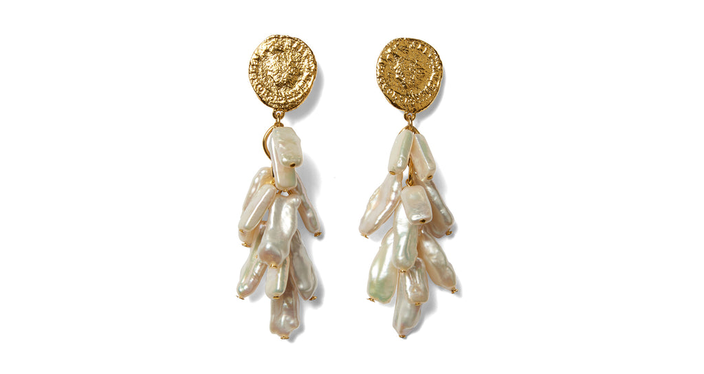Full view of Roma Earrings. Swim into the style current with these ocean-inspired natural be...