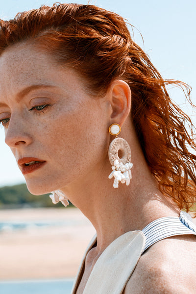 Thumbnail of model wearing the Ischia Earrings. We're fit to be 'tide' for the gorgeous gold...