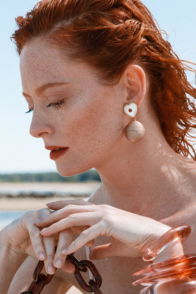 Thumbnail of model wearing the New Crush Earrings. No use trying to hide it-- we are totally...