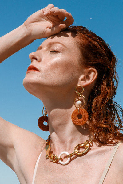 Thumbnail of model wearing the Santa Ana Earrings. Rekindle that summer style passion in thi...