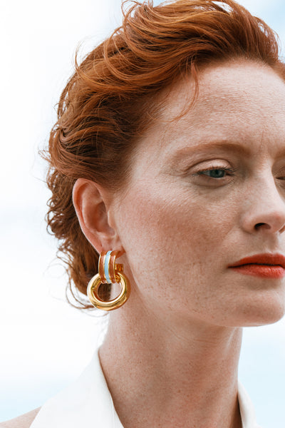 Thumbnail of model wearing the Piazza Earrings In Marine. Knock knock, your smartest new acc...