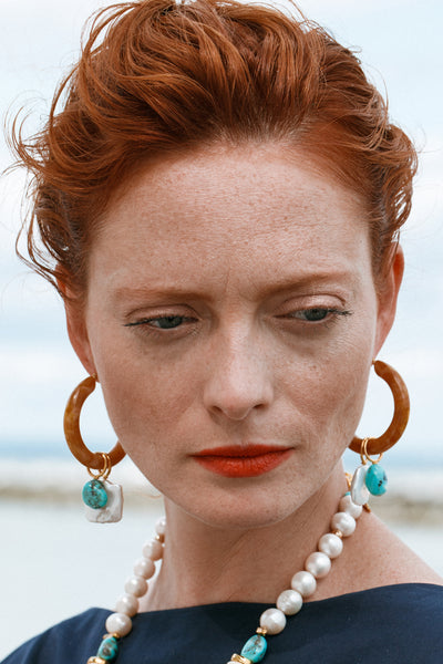Thumbnail of model wearing the Spritz Hoops In Adriatic. Rich turquoise, marbled tortoise ac...