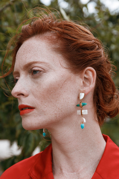 Thumbnail of model wearing the Azores Earrings. Channel the dramatic waters, green pastures ...