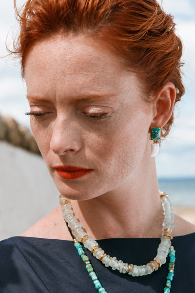 Thumbnail of model wearing the Deep Dive Earrings. You'll be sure to make waves with the edg...