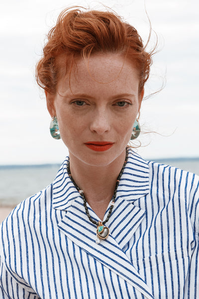 Thumbnail of model wearing the Arp Earrings In Dotted Aqua. You asked, we answered! Our best...