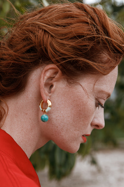 Thumbnail of model wearing the Life Saver Hoops In Pistachio. Inspired by the colorful strip...