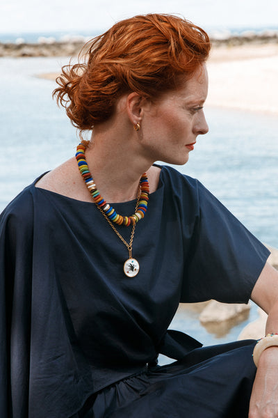 Thumbnail of model wearing the Fortune Necklace In Flora. Lizzie has yet again created a cov...