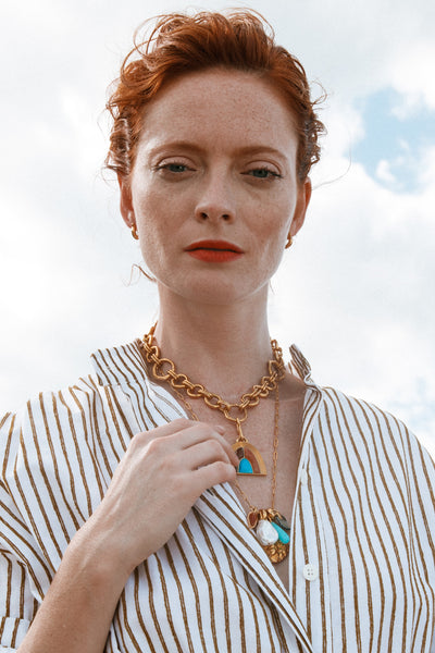 Thumbnail of model wearing the Pot Of Gold Necklace In Seaside. Evoking the deep, saturated ...