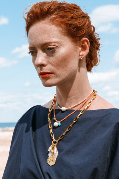 Thumbnail of model wearing the Bellagio Necklace. The coast is clear to bask in the easy, li...