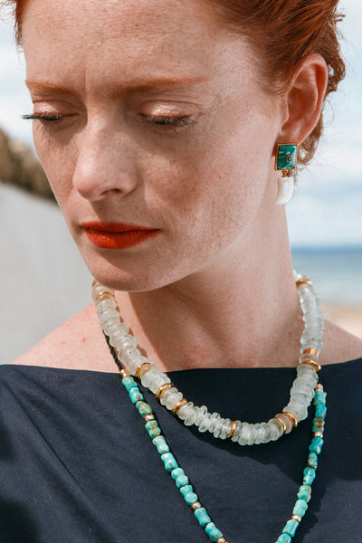 Thumbnail of model wearing the Laguna Necklace In Aqua. The Laguna is our easiest-to-wear si...