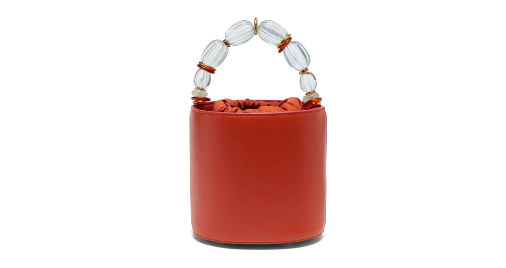 Full view of Florent Bag In Persimmon. Buon Giorno! Wake up your wardrobe with our chic popp...