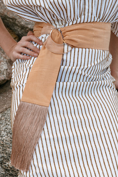 Thumbnail of model wearing the Brigitte Belt In Tan Fringe. Ciao bella! Our beloved Brigitte...