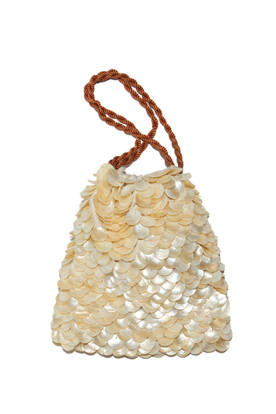 Thumbnail of Gala Wristlet In Beachcomber. Possibly our most popular new clutch style (especially amongst all the editors at Fashion Week), the brand new Beachcomber drawstring purse is the perfect honeymoon or vacation weekend wristlet. We love the layered pearl motif - it feels like a treasure from the sea.