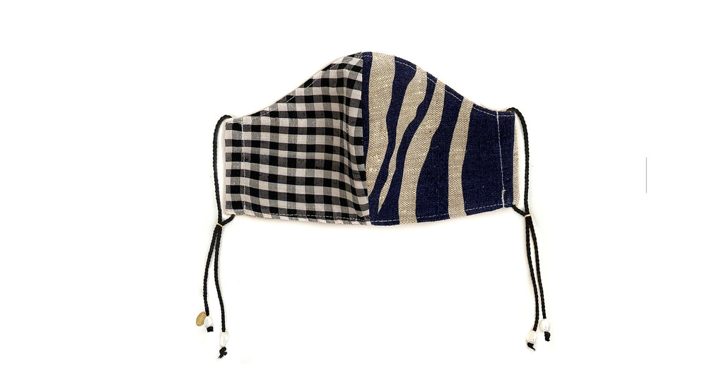 Face Mask In Dusk. Face mask featuring black and white gingham and blue and gray zebra print...