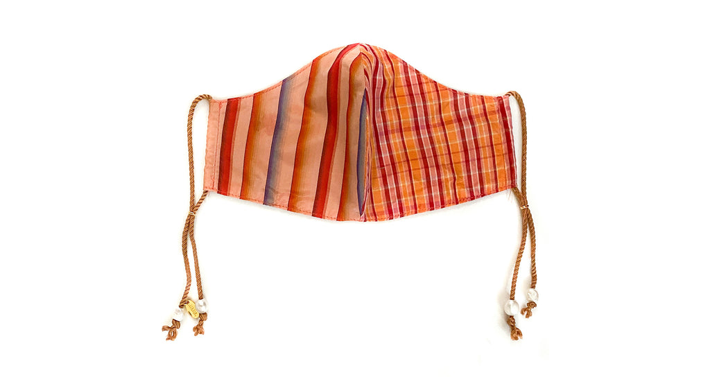 Face Mask in Golden Hour. Face mask featuring multicolored stripe and plaid silk fabric with...