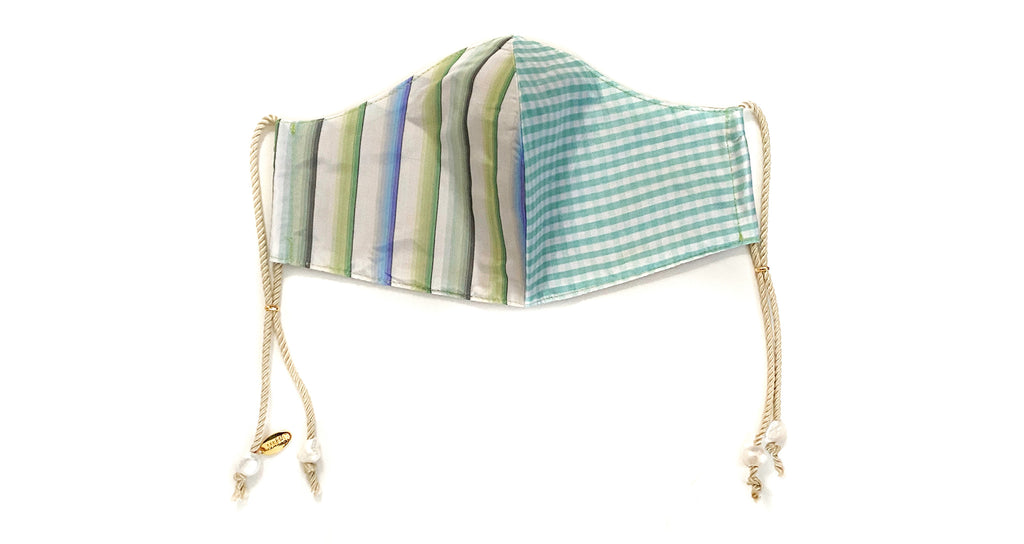 Face Mask in Palma. Face mask featuring multicolored stripe and gingham silk fabric with han...