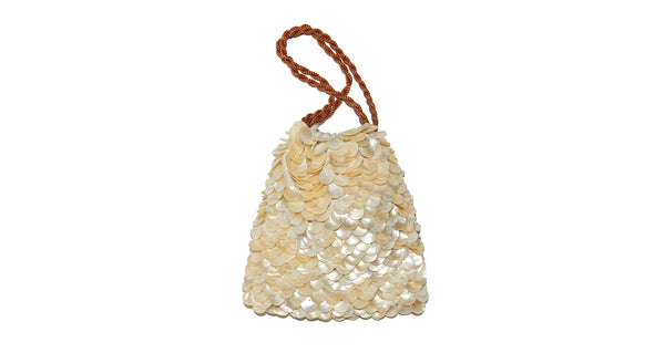Full view of Gala Wristlet In Beachcomber. Possibly our most popular new clutch style (especially amongst all the editors at Fashion Week), the brand new Beachcomber drawstring purse is the perfect honeymoon or vacation weekend wristlet. We love the layered pearl motif - it feels like a treasure from the sea.