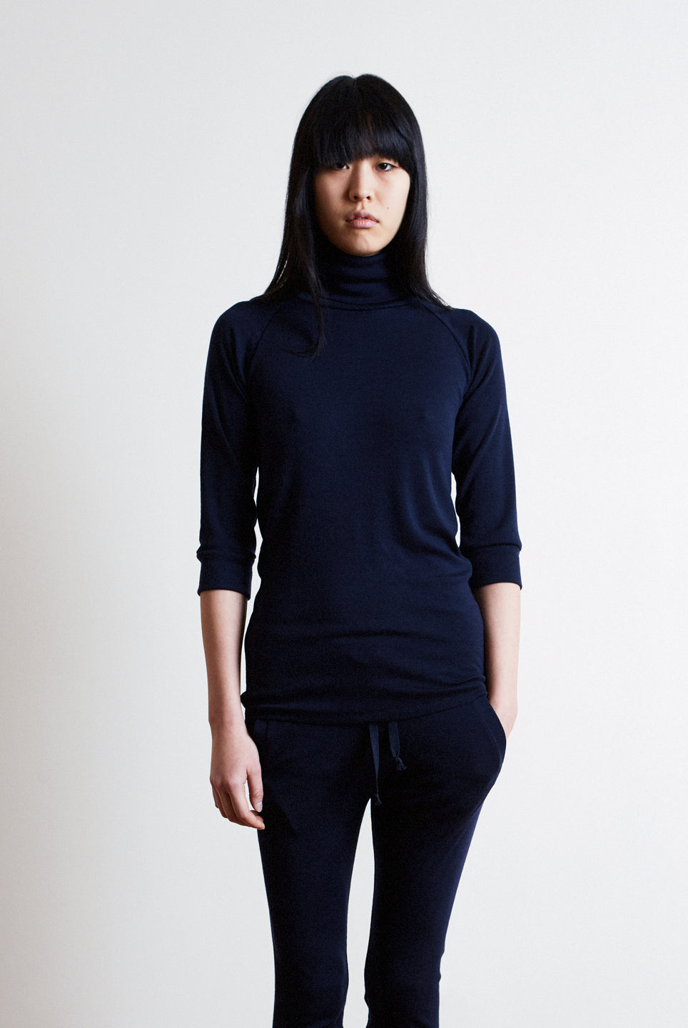 the white briefs 3/4 sleeve roll-neck sweater in 100% fine merino wool rib