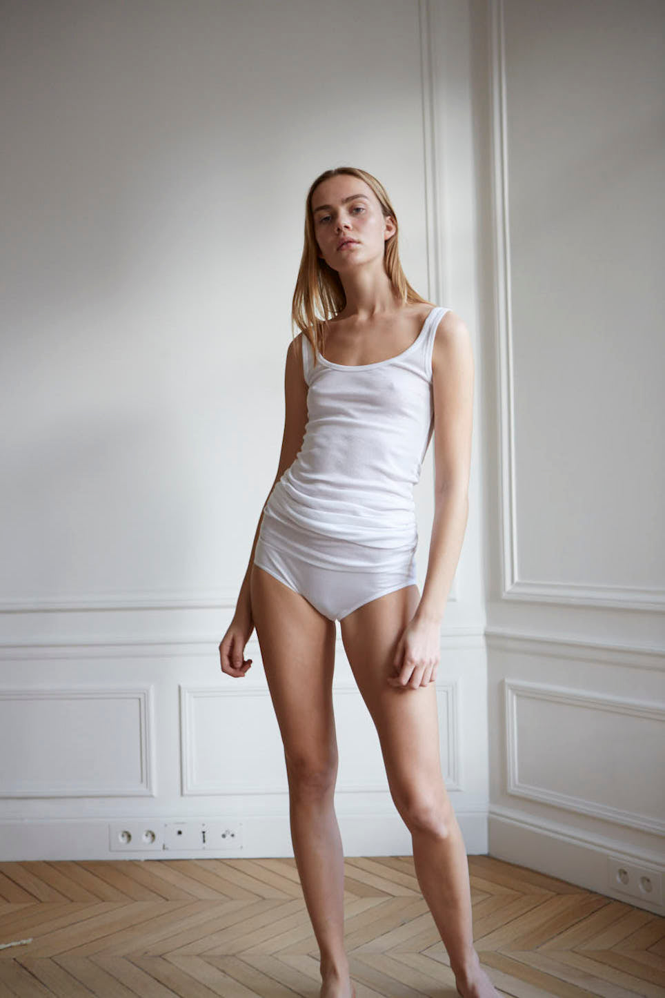 Long length white organic cotton singlet with a slim fit for women by The White Briefs