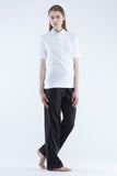 The White Briefs polo shirt in organic cotton drop needle