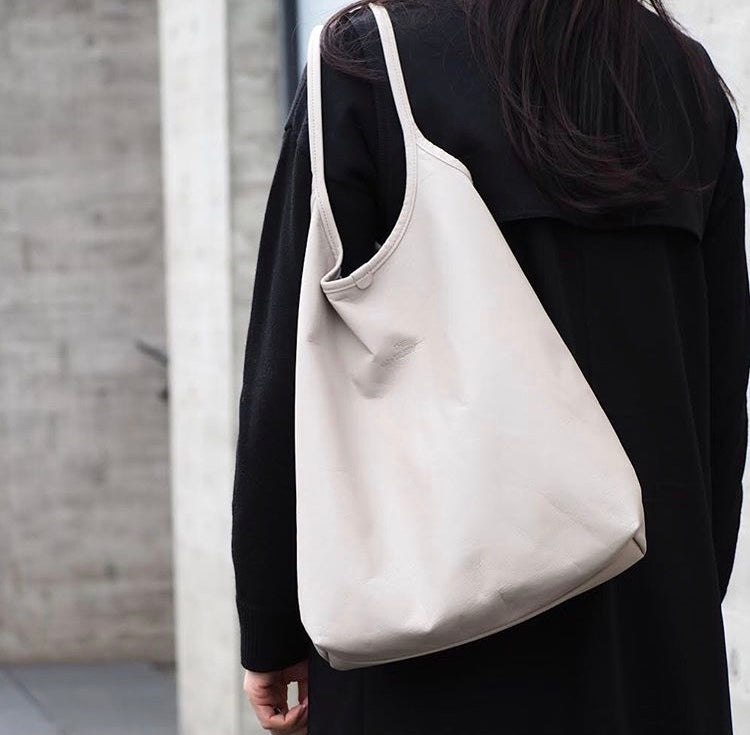 Unisex leather carry all white bag