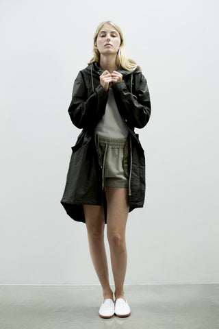 Water resistant jacket for women with hood made from a recycled organic cotton linen in dark khaki