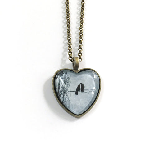 Delicate Balance of Love Heart-Shaped Glass Pendant