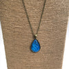 Blue Feathers Teardrop-Shaped Glass Pendant