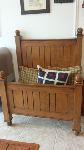 Panelled wood twin bed
