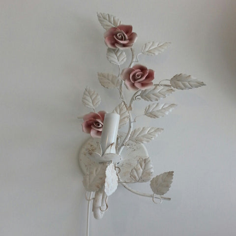 Metal leaf sconce with ceramic flowers