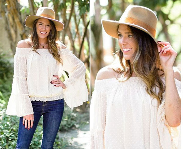 white boho top with jeans and floppy hat