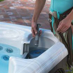 Person inserts Silver Ion into Hot Tub - Silver Ion Reno, Sparks, San Jose, Santa Cruz