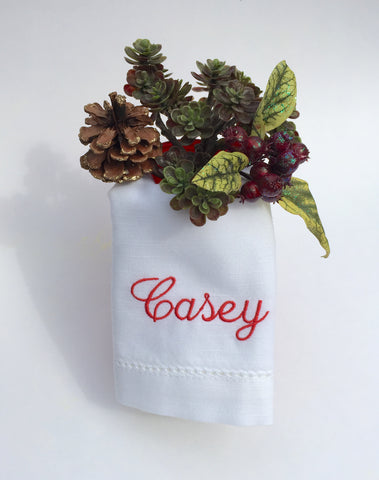 Christmas monogrammed napkins with names folded for a perfect Christmas table.  Mason jar ideas