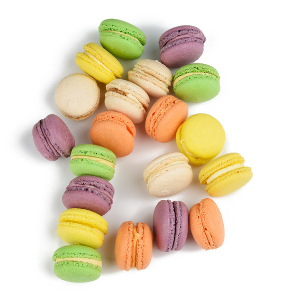 A pile of delicious macarons made by Lady Yum sitting on a counter at their Kirkland location
