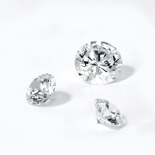 loose diamonds on a white background