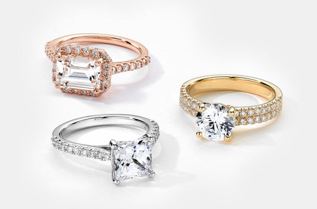 a rose gold, yellow gold, and white gold engagement ring