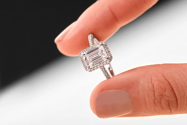 emerald cut engagement ring with a diamond halo