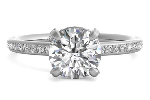 hidden halo engagement ring with sidestones