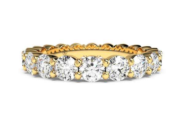 yellow gold shared prong eternity ring