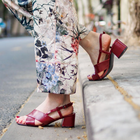 Women wearing red paco sandals