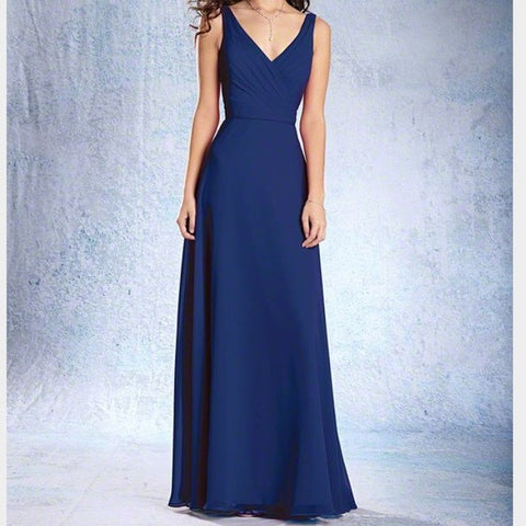 Floor length chiffon bridesmaid gown with a V shaped neckline, natural waist surplice bodice with piping at the waistline, and a circular cut skirt