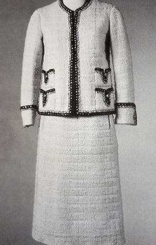 Chanel jacket in white tweed with black trim