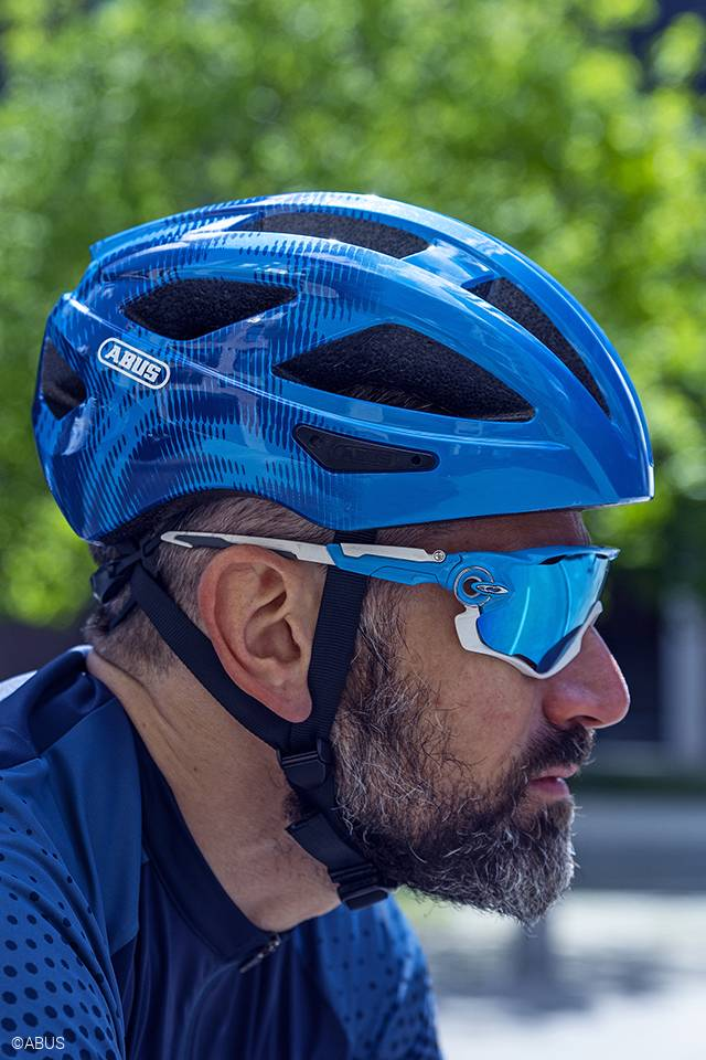 cyclist wearing abus macator bicycle helmet in steel blue, sidev iew