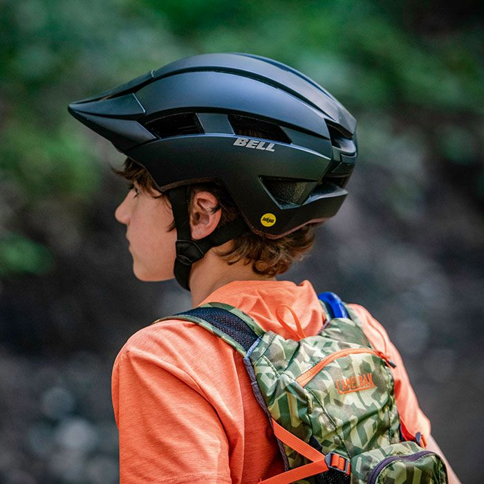 youth wearing bell sidetrack II mountain bike helmet, rear view